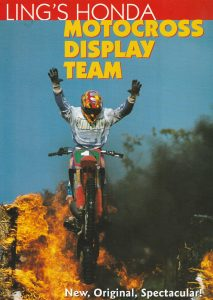 stunt rider on motorcycle having just jumped through flames